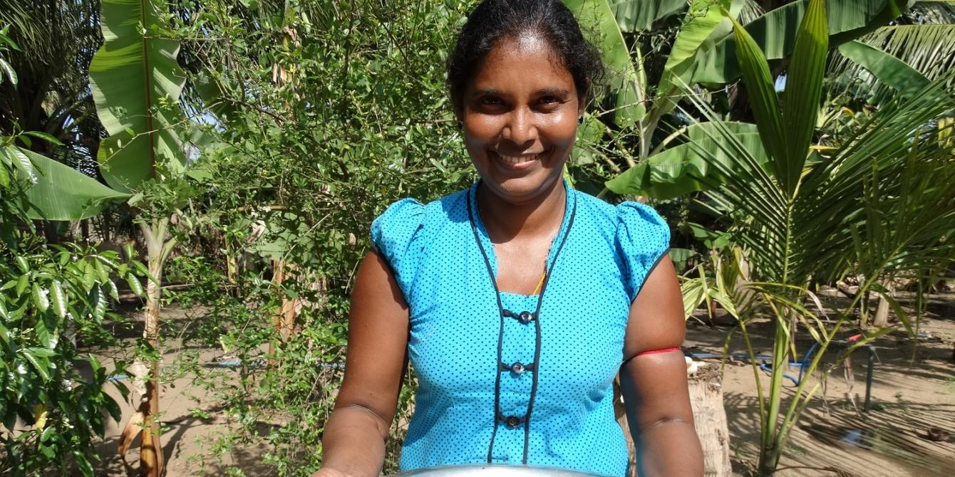 36-year-old Kasinathan Santhirathevi is happy that she earns more and mentors others in her village. Photograph: Oxfam
